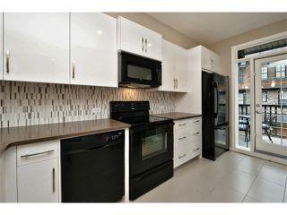 Photo 6: 312 ASCOT Circle SW in Calgary: Aspen Woods House for sale : MLS®# C4003191