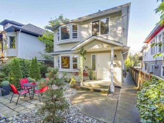 Photo 1: 1749 E 13TH Avenue in Vancouver: Grandview VE House 1/2 Duplex for sale (Vancouver East)  : MLS®# R2115872