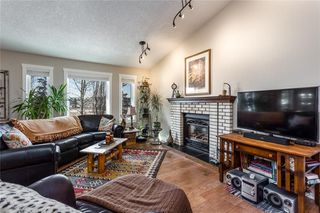 Photo 10: 12 WEST PARK Place: Cochrane House for sale : MLS®# C4178038