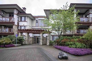 "Photo 1: 105 16469 64 Avenue in Surrey: Cloverdale BC Condo for sale in ""St. Andrews"" (Cloverdale)  : MLS®# R2262272"