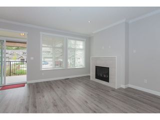 """Photo 3: 21 7138 210 Street in Langley: Willoughby Heights Townhouse for sale in """"Prestwick"""" : MLS®# R2307628"""