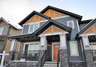 Photo 1: 161 HAWKS RIDGE Boulevard NW in Edmonton: Zone 59 House Half Duplex for sale : MLS®# E4151128