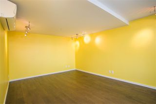 "Photo 11: 103 7788 ACKROYD Road in Richmond: Brighouse Condo for sale in ""QUINTET TOWER D"" : MLS®# R2386368"