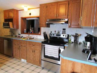 "Photo 6: 5246 PEACEVIEW Road in Fort St. John: Fort St. John - Rural E 100th Manufactured Home for sale in ""NORTH TAYLOR"" (Fort St. John (Zone 60))  : MLS®# N233162"
