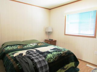 "Photo 12: 5246 PEACEVIEW Road in Fort St. John: Fort St. John - Rural E 100th Manufactured Home for sale in ""NORTH TAYLOR"" (Fort St. John (Zone 60))  : MLS®# N233162"