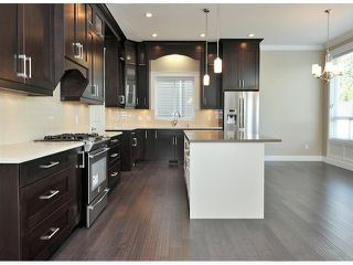 """Photo 2: 16951 79TH Avenue in Surrey: Fleetwood Tynehead House for sale in """"THE LINKS"""" : MLS®# F1412362"""