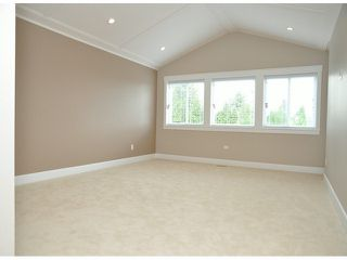 "Photo 12: 16951 79TH Avenue in Surrey: Fleetwood Tynehead House for sale in ""THE LINKS"" : MLS®# F1412362"