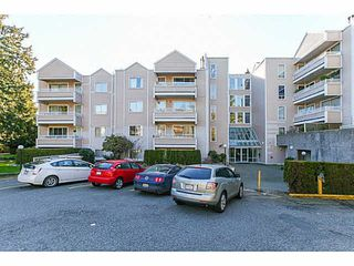 Photo 2: 204 9644 134TH Street in Surrey: Whalley Condo for sale (North Surrey)  : MLS®# F1433116