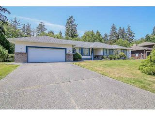 "Photo 1: 8107 148A Street in Surrey: Bear Creek Green Timbers House for sale in ""MORNINGSIDE"" : MLS®# F1447269"