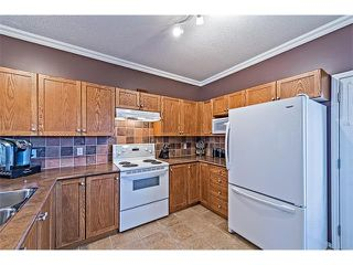 Photo 10: 301 2006 LUXSTONE Boulevard SW: Airdrie House  : MLS®# C4034048