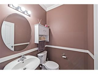 Photo 12: 301 2006 LUXSTONE Boulevard SW: Airdrie House  : MLS®# C4034048