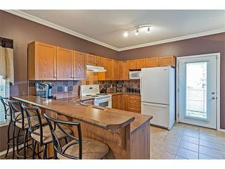 Photo 9: 301 2006 LUXSTONE Boulevard SW: Airdrie House  : MLS®# C4034048
