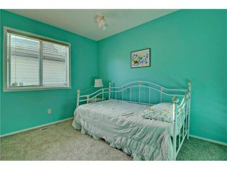 Photo 17: 125 SPRING Crescent SW in Calgary: Springbank Hill House for sale : MLS®# C4077797