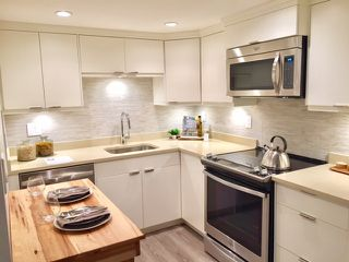 """Photo 1: 107 215 N TEMPLETON Drive in Vancouver: Hastings Condo for sale in """"PORTO VISTA"""" (Vancouver East)  : MLS®# R2120278"""