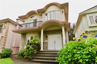 Photo 1: 6096 DICKENS Street in Burnaby: Upper Deer Lake House for sale (Burnaby South)  : MLS®# R2312960