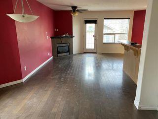 Photo 3: 15 Spring Meadows Bay: Okotoks Row/Townhouse for sale : MLS®# A1052438