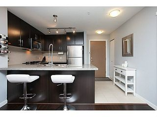 """Photo 8: 211 701 KLAHANIE Drive in Port Moody: Port Moody Centre Condo for sale in """"THE LODGE AT NAHANNI"""" : MLS®# V1138856"""