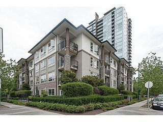 """Photo 1: 211 701 KLAHANIE Drive in Port Moody: Port Moody Centre Condo for sale in """"THE LODGE AT NAHANNI"""" : MLS®# V1138856"""