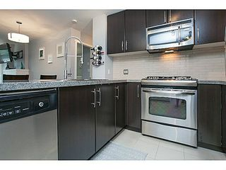 """Photo 7: 211 701 KLAHANIE Drive in Port Moody: Port Moody Centre Condo for sale in """"THE LODGE AT NAHANNI"""" : MLS®# V1138856"""