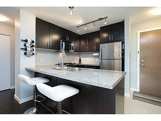 """Photo 6: 211 701 KLAHANIE Drive in Port Moody: Port Moody Centre Condo for sale in """"THE LODGE AT NAHANNI"""" : MLS®# V1138856"""