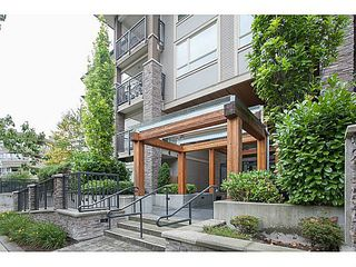 """Photo 2: 211 701 KLAHANIE Drive in Port Moody: Port Moody Centre Condo for sale in """"THE LODGE AT NAHANNI"""" : MLS®# V1138856"""