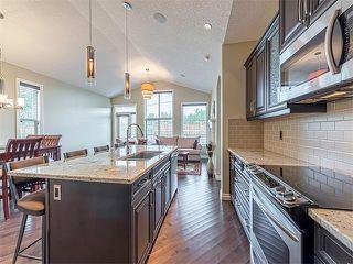 Photo 10: 113 ROCKFORD Road NW in Calgary: Rocky Ridge House for sale : MLS®# C4079306