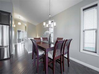Photo 3: 113 ROCKFORD Road NW in Calgary: Rocky Ridge House for sale : MLS®# C4079306