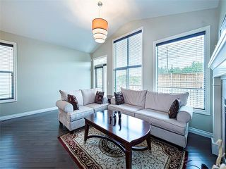 Photo 5: 113 ROCKFORD Road NW in Calgary: Rocky Ridge House for sale : MLS®# C4079306