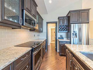Photo 8: 113 ROCKFORD Road NW in Calgary: Rocky Ridge House for sale : MLS®# C4079306