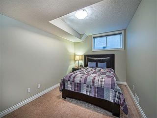 Photo 26: 113 ROCKFORD Road NW in Calgary: Rocky Ridge House for sale : MLS®# C4079306