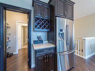 Photo 9: 113 ROCKFORD Road NW in Calgary: Rocky Ridge House for sale : MLS®# C4079306