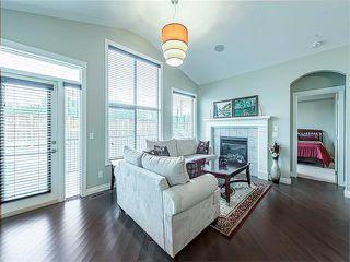 Photo 4: 113 ROCKFORD Road NW in Calgary: Rocky Ridge House for sale : MLS®# C4079306