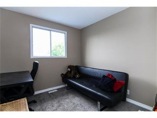 Photo 17: 138 ERIN RIDGE Road SE in Calgary: Erin Woods House for sale : MLS®# C4085060