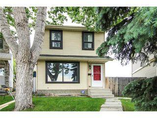 Photo 1: 138 ERIN RIDGE Road SE in Calgary: Erin Woods House for sale : MLS®# C4085060