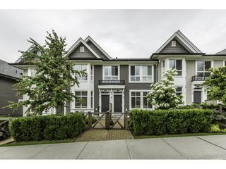 "Photo 1: 11 14433 60 Avenue in Surrey: Sullivan Station Townhouse for sale in ""BRIXTON"" : MLS®# R2179960"