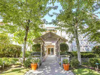 "Photo 1: 106 6363 121 Street in Surrey: Panorama Ridge Condo for sale in ""THE REGENCY"" : MLS®# R2198404"