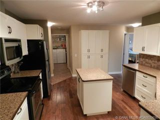 Photo 7: 103 3501 49 Avenue in Red Deer: RR South Hill Residential Condo for sale : MLS®# CA0033656
