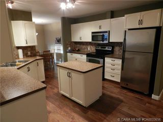 Photo 2: 103 3501 49 Avenue in Red Deer: RR South Hill Residential Condo for sale : MLS®# CA0033656