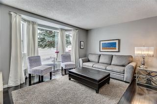 Photo 2: 207 STRATHEARN Crescent SW in Calgary: Strathcona Park House for sale : MLS®# C4165815