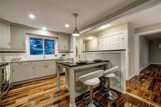 Photo 5: 6256 SILVER SPRINGS Hill(S) NW in Calgary: Silver Springs House for sale : MLS®# C4171864