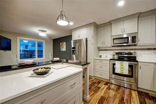 Photo 7: 6256 SILVER SPRINGS Hill(S) NW in Calgary: Silver Springs House for sale : MLS®# C4171864