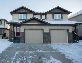 Main Photo: 21311 94 Avenue in Edmonton: Zone 58 House Half Duplex for sale : MLS®# E4139855