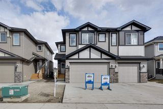 Photo 1: 8540 CUSHING Place in Edmonton: Zone 55 House Half Duplex for sale : MLS®# E4151938