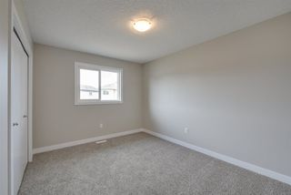 Photo 25: 8540 CUSHING Place in Edmonton: Zone 55 House Half Duplex for sale : MLS®# E4151938