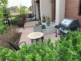 Photo 4: 120 ASPEN HILLS Villa SW in Calgary: Aspen Woods Row/Townhouse for sale : MLS®# C4242646