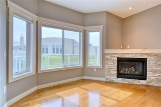 Photo 14: 64 RIVER HEIGHTS View: Cochrane Semi Detached for sale : MLS®# C4300497
