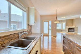 Photo 5: 64 RIVER HEIGHTS View: Cochrane Semi Detached for sale : MLS®# C4300497