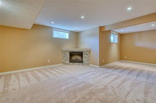 Photo 36: 64 RIVER HEIGHTS View: Cochrane Semi Detached for sale : MLS®# C4300497