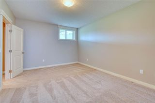Photo 40: 64 RIVER HEIGHTS View: Cochrane Semi Detached for sale : MLS®# C4300497