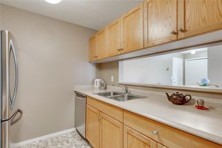 Photo 6: 3303 TUSCARORA Manor NW in Calgary: Tuscany Apartment for sale : MLS®# A1036572